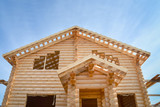 Structure of a new wooden house under construction on blue sky background - 172047991