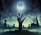 Zombie Hand Rising Out Of A Graveyard - 172051171