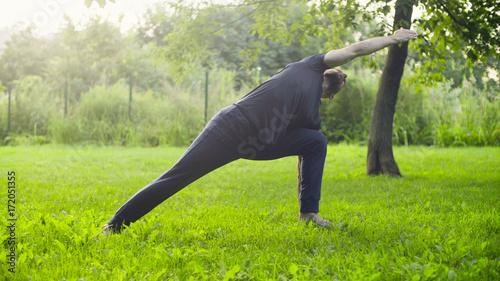 Papiers peints Vert chaux A man doing yoga exercises in the park