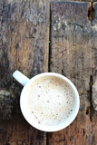 Top view of a coffee cup or cappuccino on an aged wooden table  - 172056797