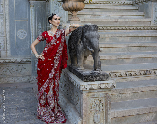 67cfdf353d Beautiful young indian woman in traditional clothing with bridal makeup and oriental  jewelry