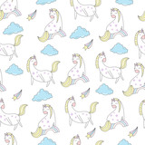 Cute unicorns and clouds seamless vector pattern