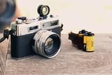 Retro vintage classic camera film on wood background - 172065542