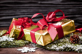 gifts boxes with fir branches on wooden background close up - 172068186