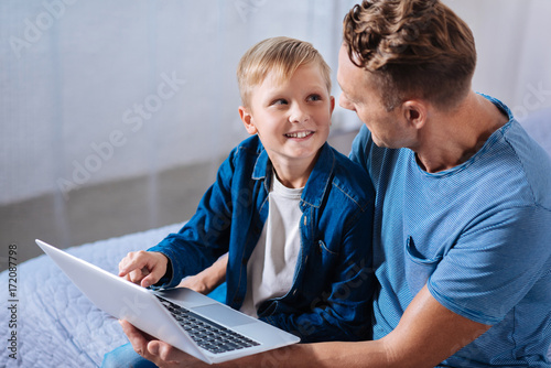 Little boy discussing cartoon with his father