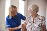 Nurse helping senior woman use a walking frame, close up - 172091317