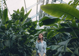 Beautiful woman working in greenhouse - 172093149