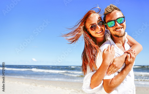 autumn time and two lovers on beach