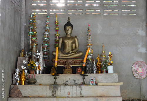 Foto op Canvas Boeddha the buddha statue and some worship .sacrifice in old room at the temple