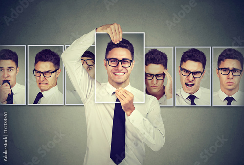 Leinwanddruck Bild Masked young man in glasses expressing different emotions