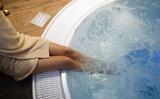 Woman enjoying jacuzzi at spa resort - 172143705