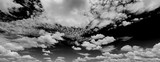 Black sky and white clouds panorama