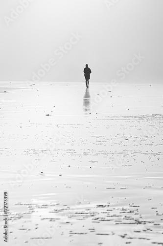 person running on beach - 172173399