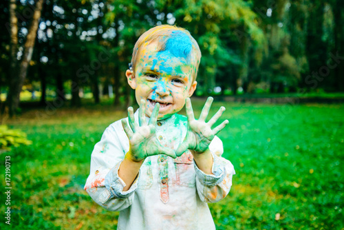 happy little kid all in holi paints Poster