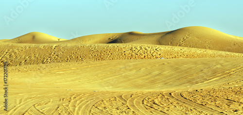 Deurstickers Dubai Nature and man-made sand dune textures in the desert outside Dubai City, United Arab Emirates