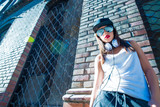 Hip hop girl with headphones in a urban environment