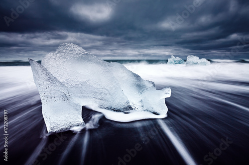 Staande foto Antarctica Ice fragments on black sand. Popular tourist attraction. Location Vatnajokull, Jokulsarlon lagoon, Iceland, Europe.