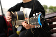 A street musician playing the guitar. - 172212975