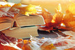 Autumn background. Stack of old books on the table among the dry yellow maple autumn leaves