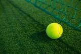 Close up of tennis ball by net