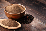 Composition with bowl of ground black pepper on wooden table - 172246390