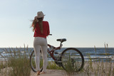 Unrecognizable woman bike cycling on sand - 172249975