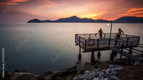 Fotobehang Zee zonsondergang scenery of sunset at Lumut,Perak,Malaysia.Soft focus.motion blur due to long exposure