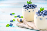 fresh blueberries and homemade yogurt on a wooden background, se