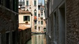 Gondola in a canal in Venice Italy - 172269509