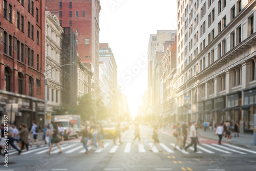 Groups of people walking across a busy crosswalk intersection in New York City w Poster