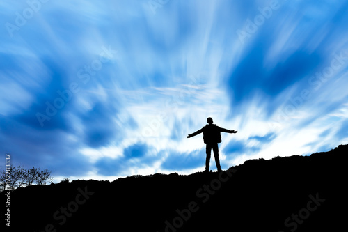 Silhouette of the man success on the peak of mountain,Sport and active life sunset landscape