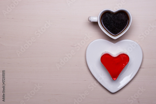 Poster Heart shaped coffee cup and cake on wood surface