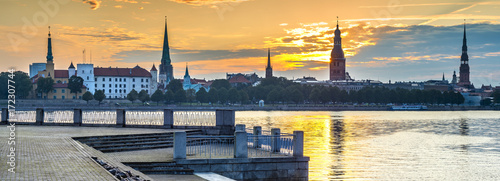 Foto op Plexiglas Panoramafoto s Medieval churches in historical center of old Riga - the capital of Latvia and famous Baltic city widely known among tourists due to its unique medieval and Gothic architecture