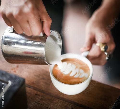 Aluminium Thailand Coffee maker pouring the milk for make latte art