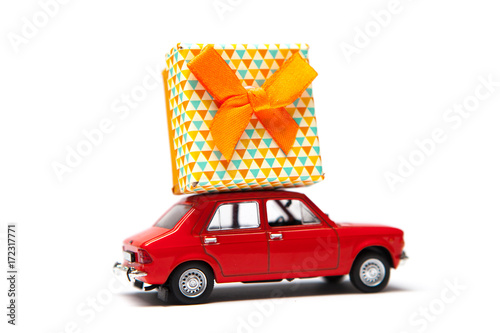 Red retro toy car with gift box for holidays