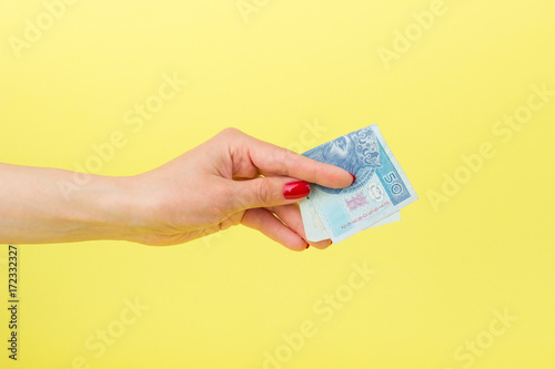 Poster Fifty zloty in the woman's hand, yellow background