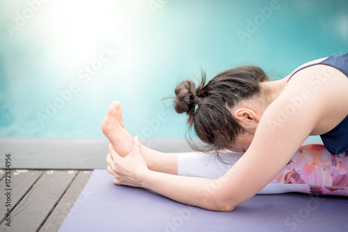 Young Asian woman doing yoga exercise