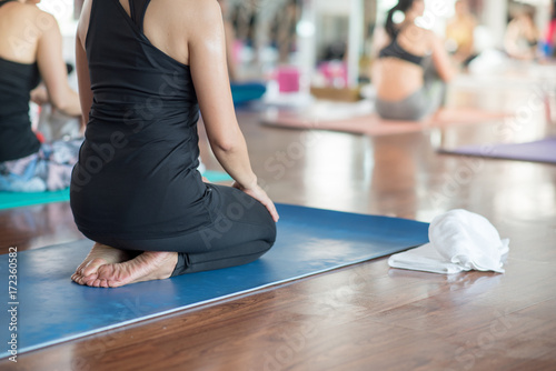 Deurstickers School de yoga Group women stretching and practices yoga in a class, healthy lifestyle and fitness concept