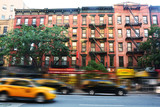 Busy New York street with many vehicles passing with speed