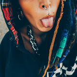 Girl piercing and dreadlocks. Close-up. City Style - 172379309