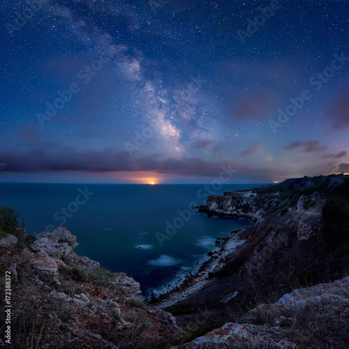 Foto op Canvas Nachtblauw Milky Way above the sea / Long time exposure night landscape with Milky Way Galaxy above the Black sea and moonrise