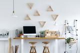 Wooden stools at a desk - 172391586