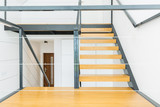 Wooden stairs and metal railing - 172391747