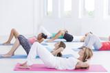 Practicioners exercise in fitness studio - 172392103