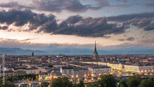 Torino Cityscape, Italia. Skyline panoramic view of Turin, Italy, at dusk with glowing city lights. The Mole Antonelliana illuminated, scenic effect. © fabio lamanna