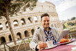 Quadro Young man sitting and having a cup of coffee in Rome, Italy