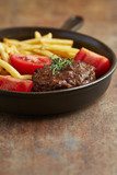 Roasted meatballs with french fries and tomatoes