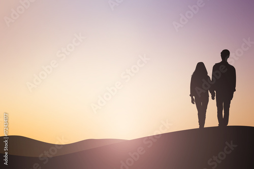 Fototapeta silhouette asian man woman lover couple dating walking on sunset hour sky background sepia tone color concept