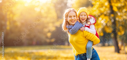 happy family mother and child daughter on   autumn walk