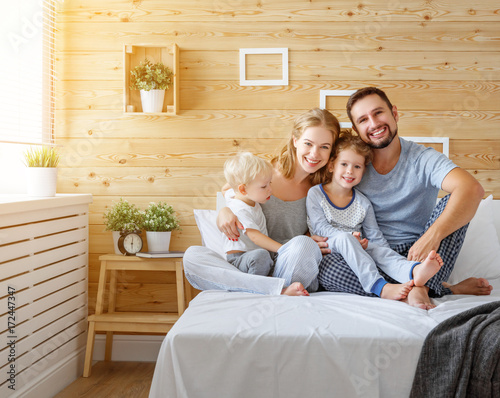 happy family mother father and children daughter and son in bed - 172447347